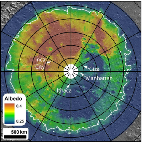 Cryptic region on the south pole of Mars. This is albedo (=reflectivity) data from the Mars Odyssey Thermal Emission Spectrometer (TES) draped over a MOLA (Mars Orbiter Laser Altimeter) shaded relief background showing considerable brightness variations. The low albedo region from 2 o'clock (300W) to 7 o'clock (160W), within the thermally defined extent of the seasonal cap (at lower right), is the cryptic region. Meridians and parallels are spaced every 30° and 5°, respectively. The zero meridian is pointing straight up. The indicated regions (with informal names) are areas that were selected for repeated coverage throughout the spring. Manhattan in particular was selected based on earlier observations from Odyssey's THEMIS instrument
