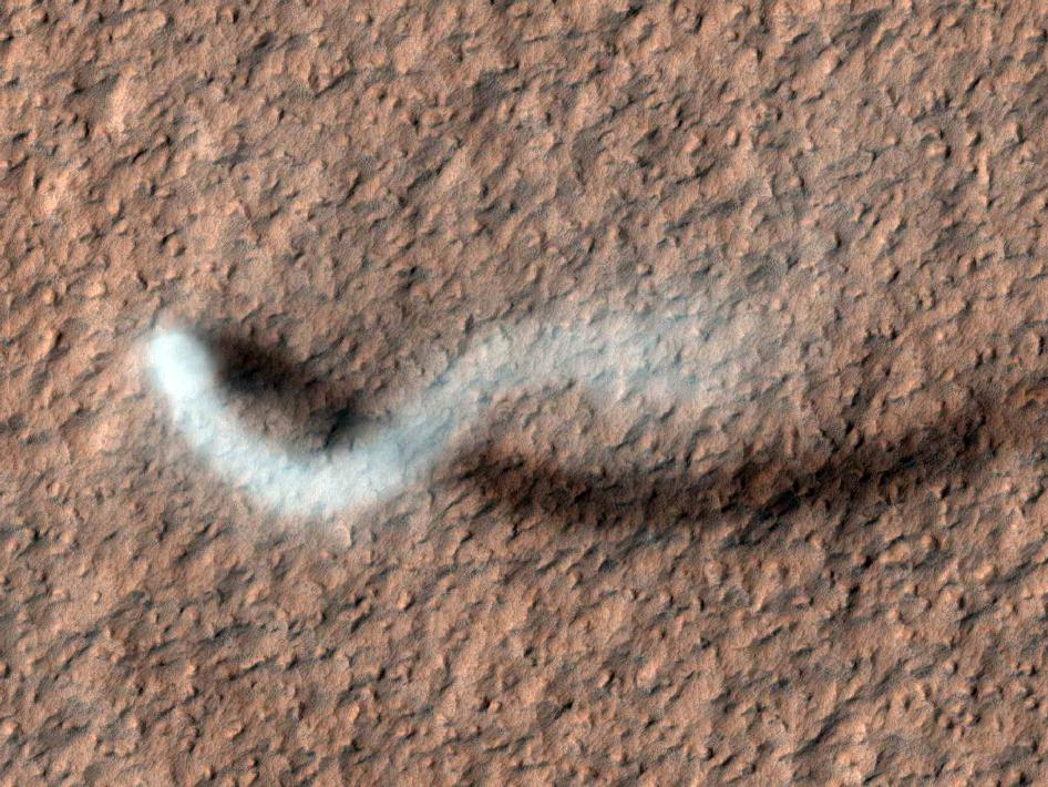A dust devil spotted from orbit. Image credit: NASA/JPL-Caltech/Univ. of Arizona - More info at http://www.nasa.gov/mission_pages/MRO/multimedia/pia15116.html