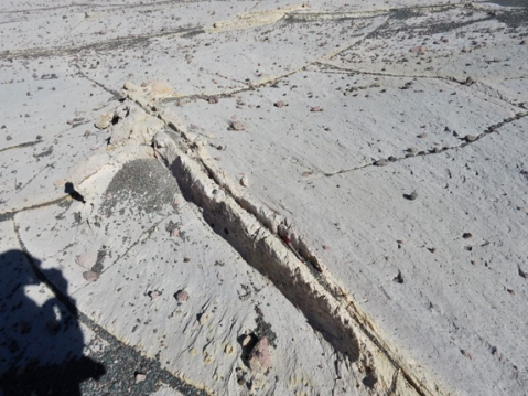 A crack that has been hardened by hot steam escaping. It has since been brought into relief by the erosion of the surrounding rock. Campo de Piedra Pomez, Argentina.